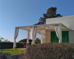 Wall-mounted pergola at the Elba Island in Italy